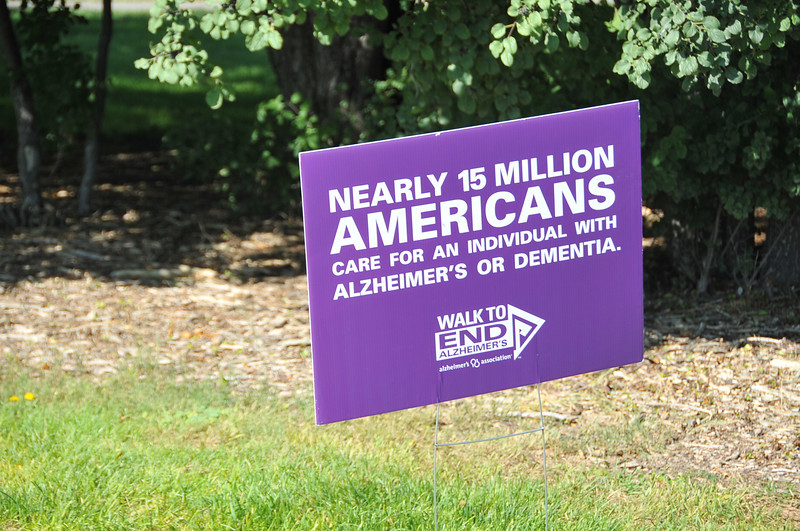 Educational signs with information about Alzheimer's disease and dementia lined the sidewalk around Columbine Park Saturday morning, Aug. 24, 2013, for the Walk to End Alzheimer's.