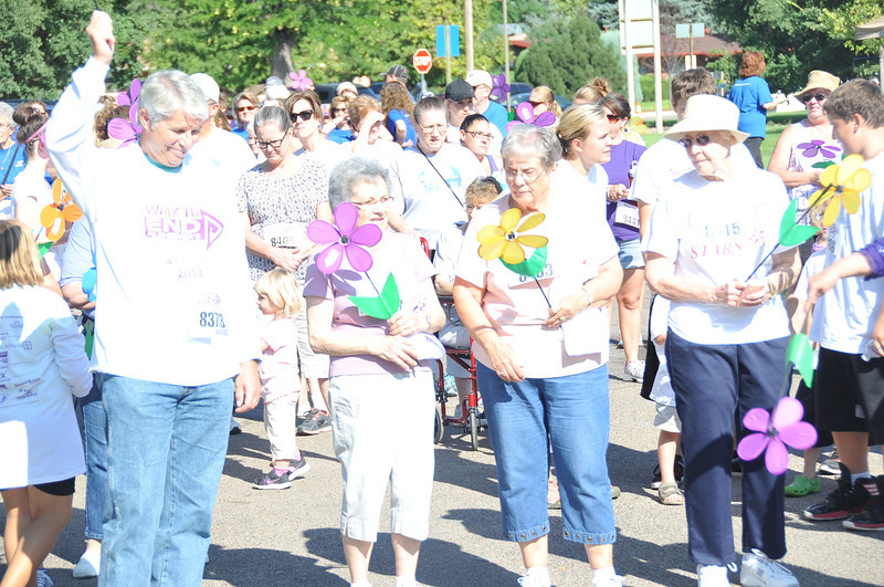 Participants gather at Columbine Park before the start of the Walk to End Alzheimer's Saturday, Aug. 24, 2013.