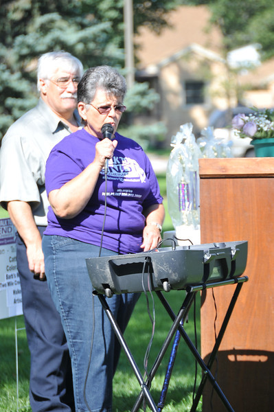 Emcee Kathy Kaufman addresses the participants at the Walk to End Alzheimer's Saturday, Aug. 24, 2013.