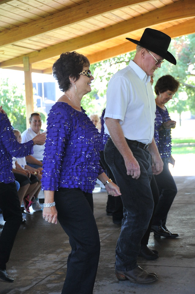 Boots in Motion performs a line dance during  the Walk to End Alzheimer's Saturday, Aug. 24, 2013, at Columbine Park.