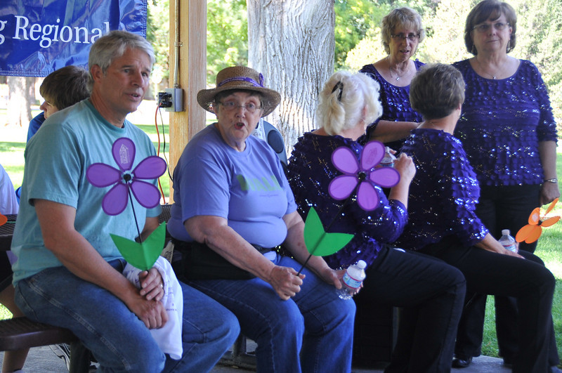 Participants chat in the Columbine Park pavilion after their lap around the park for the Walk to End Alzheimer's Saturday, Aug. 24, 2013.