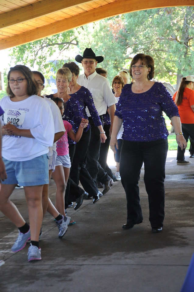 Participants show off their line dancing moves at  the Walk to End Alzheimer's Saturday, Aug. 24, 2013, at Columbine Park.