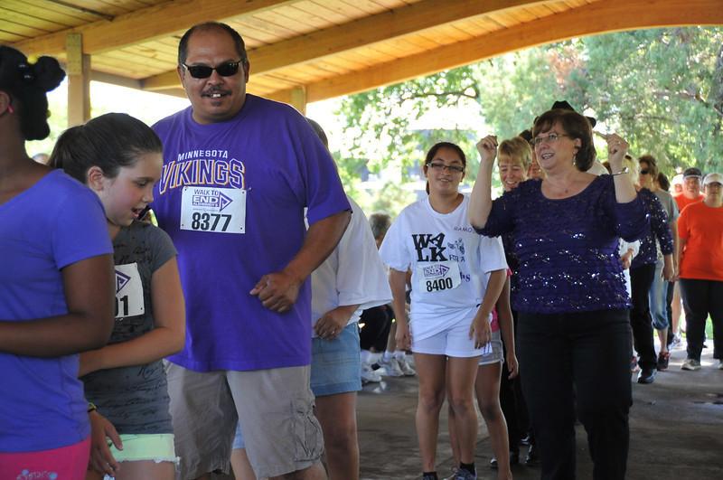 Dene Carter teaches the electric slide to participants in  the Walk to End Alzheimer's Saturday, Aug. 24, 2013, at Columbine Park.
