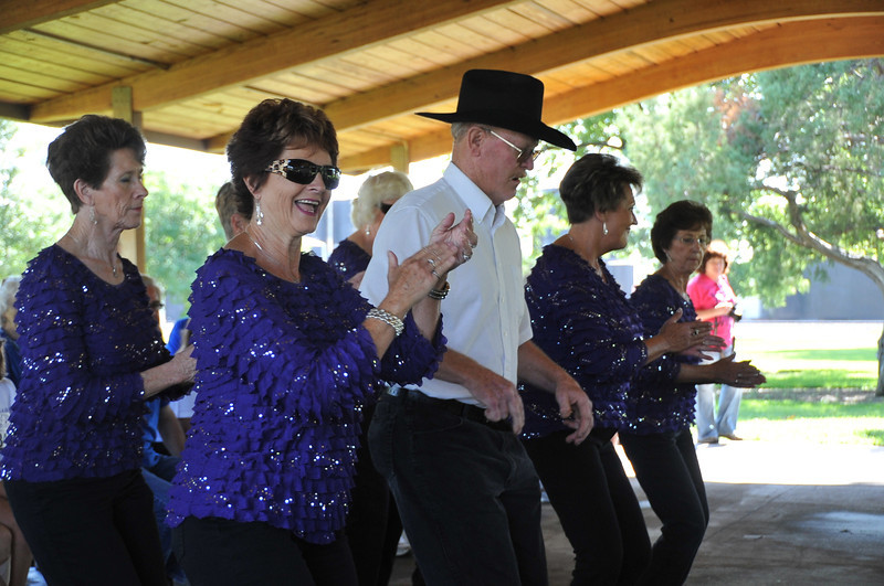 Boots in Motion performs for the participants at the Walk to End Alzheimer's Saturday, AUg. 24, 2013, at Columbine Park.