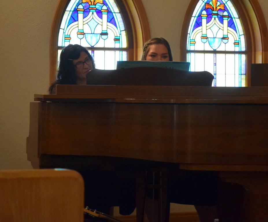 """. Mallory Kaiser, joined by Darla Korrey, performs \""""Alexander March\"""" on the piano during a Recital of the Harmoic Horizons Conservatory and Studio of Darla Korrey Sunday, April 28, 2019."""