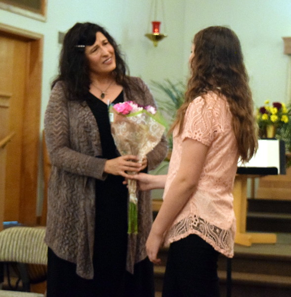 Darla Korrey accepts flowers from one of her students, Mikayla von Steinman, at the conclusion of a Recital of the Harmoic Horizons Conservatory and Studio of Darla Korrey Sunday, April 28, 2019.