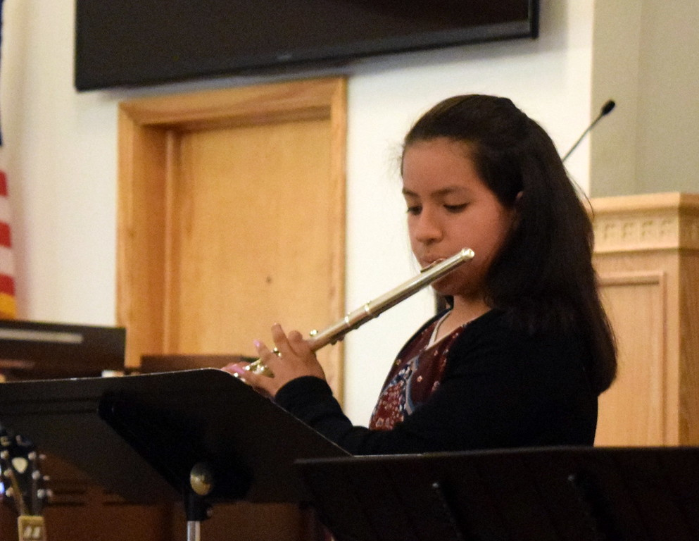 ". Alana Moreno performs ""Cakewalk\"" on the flute during a Recital of the Harmoic Horizons Conservatory and Studio of Darla Korrey Sunday, April 28, 2019."
