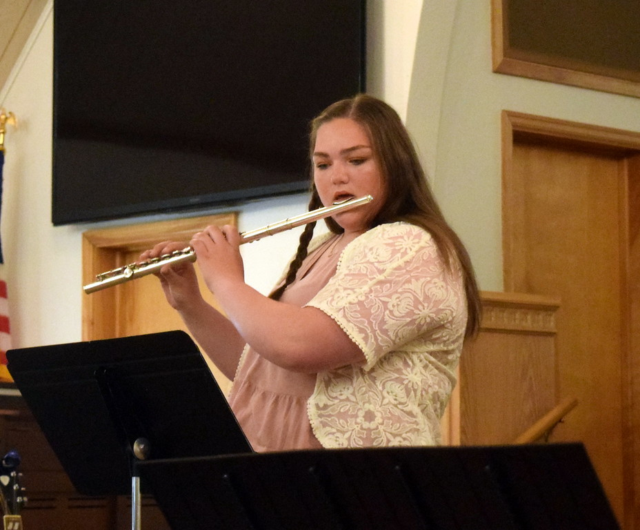 """. Mallory Kaiser performs \""""Poppy/Air Ecossais\"""" on the flute during a Recital of the Harmoic Horizons Conservatory and Studio of Darla Korrey Sunday, April 28, 2019."""