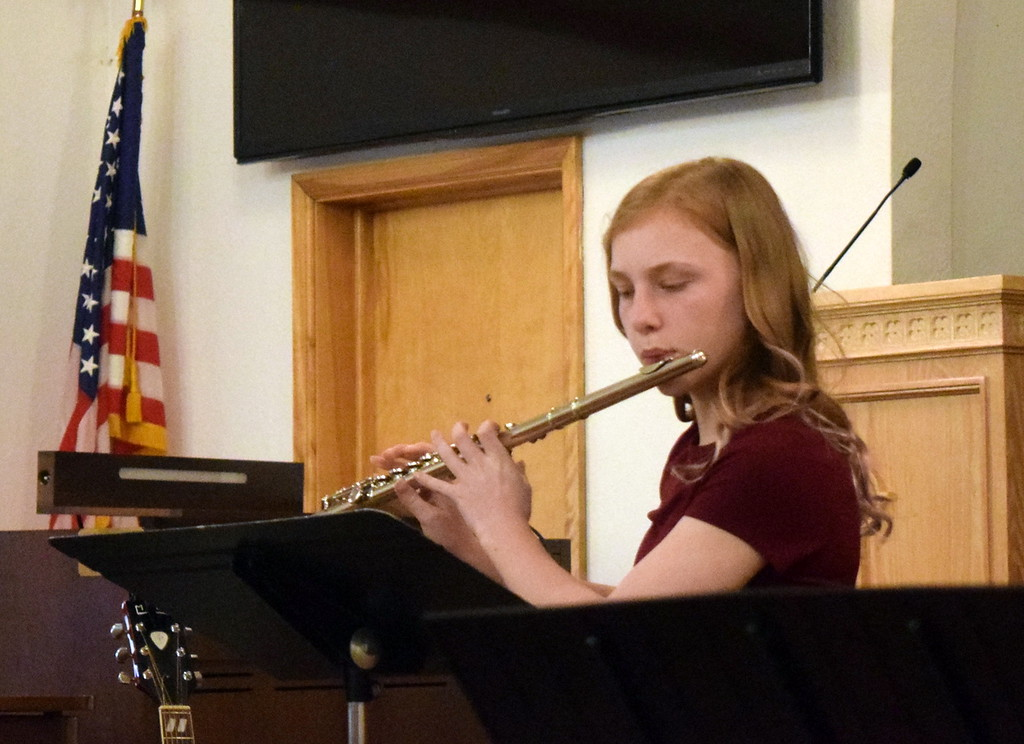 ". Teagan Tennant performs ""Allemande\"" on the flute during a Recital of the Harmoic Horizons Conservatory and Studio of Darla Korrey Sunday, April 28, 2019."
