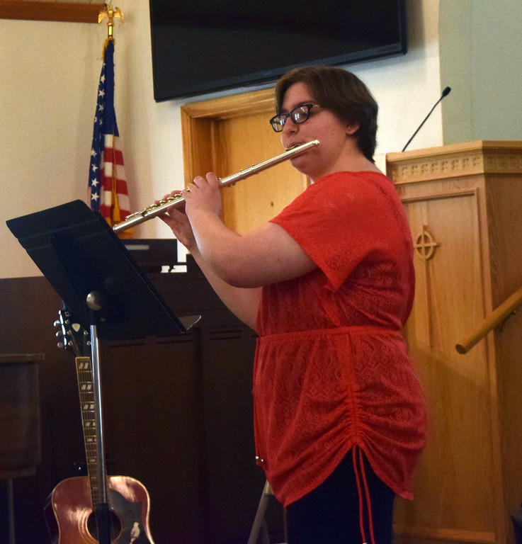 """. Camryn Trump performs \""""Chanson de Matin\"""" on the flute during a Recital of the Harmoic Horizons Conservatory and Studio of Darla Korrey Sunday, April 28, 2019."""