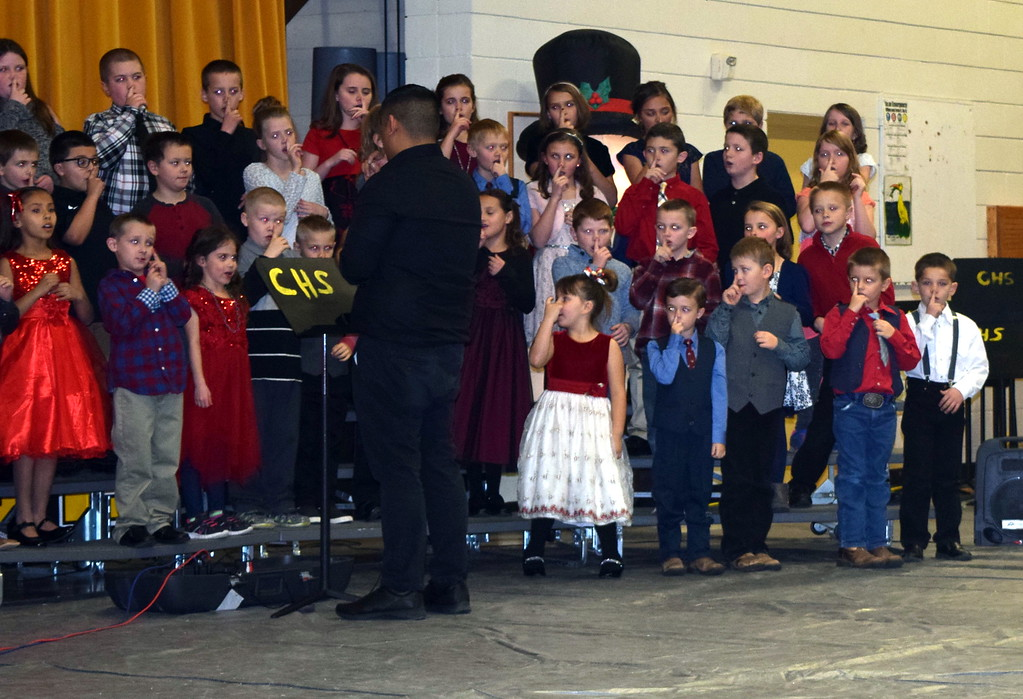 ". Caliche Elemenary singers perform ""Rudolph the Red Nosed Reindeer,\"" under the direction of Ryan Rosete, at the school\'s holiday program Tuesday, Dec. 4, 2018."
