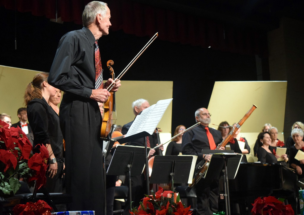 """. The sinfonia stands for applause at Master Chorale\'s \""""27th Noel\"""" Christmas Concert Sunday, Dec. 9, 2018."""
