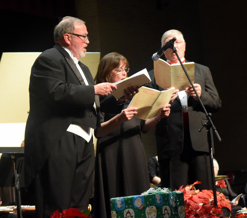 """. From left; tenor soloist Don Johnson, soprano soloist Nita Gillham and bass soloist Richard Gillham sing during a performance of \""""My Soul Doth Magnify\"""" at Master Chorale\'s \""""27th Noel\"""" Christmas Concert Sunday, Dec. 9, 2018."""