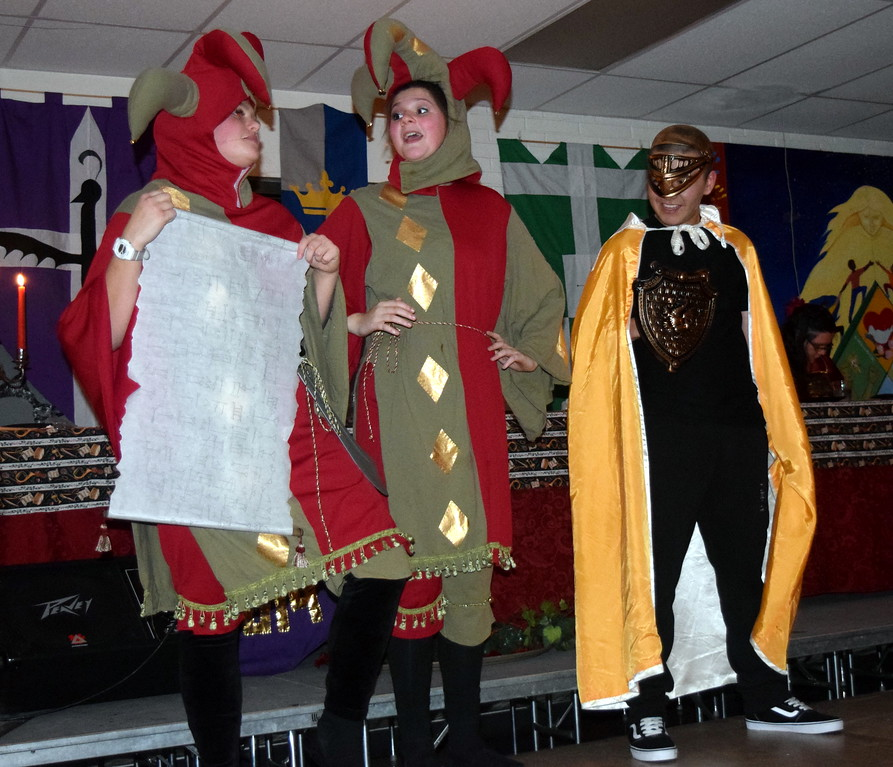 . The Jesters (Hope Jackson, left, and Katie von Steinman) have some fun with one of the Knights (Keanu Renteria) during Sterling High School\'s Madrigal Dinner Monday, Dec. 3, 2018.