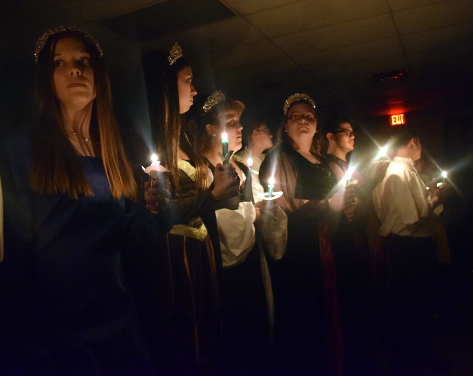 ". Sterling High School choir students light candles and sing ""Silent Night\"" at the close of the Madrigal Dinner on Monday, Dec. 3, 2018."