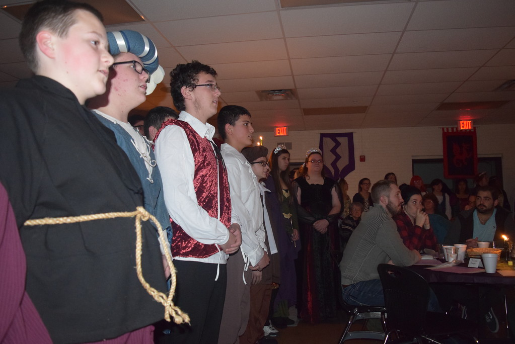 ". Sterling High School choir students sing the ""Wassail Song\"" during the school\'s Madrigal DInner Monday, Dec. 3, 2018."
