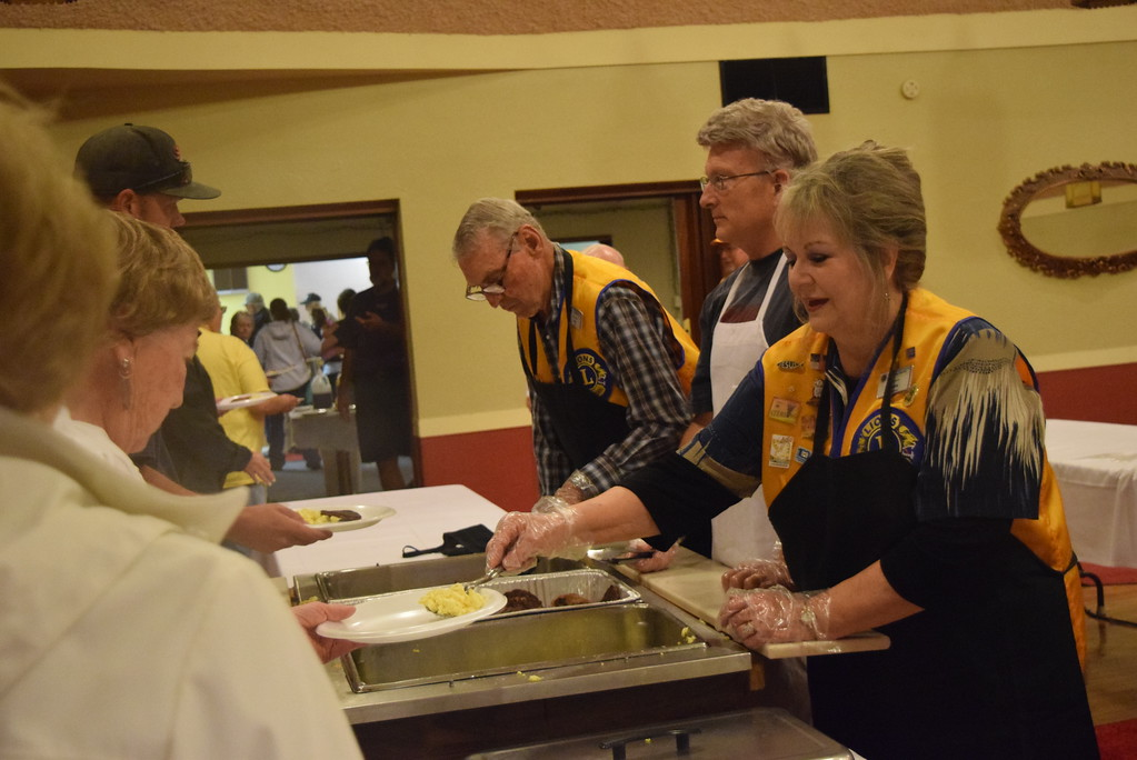 . Sterling Lions Club members serve up eggs, sausage and pancakes for hungry folks at the club\'s annual Cowboy Breakfast Wednesday, Aug. 8, 2018.