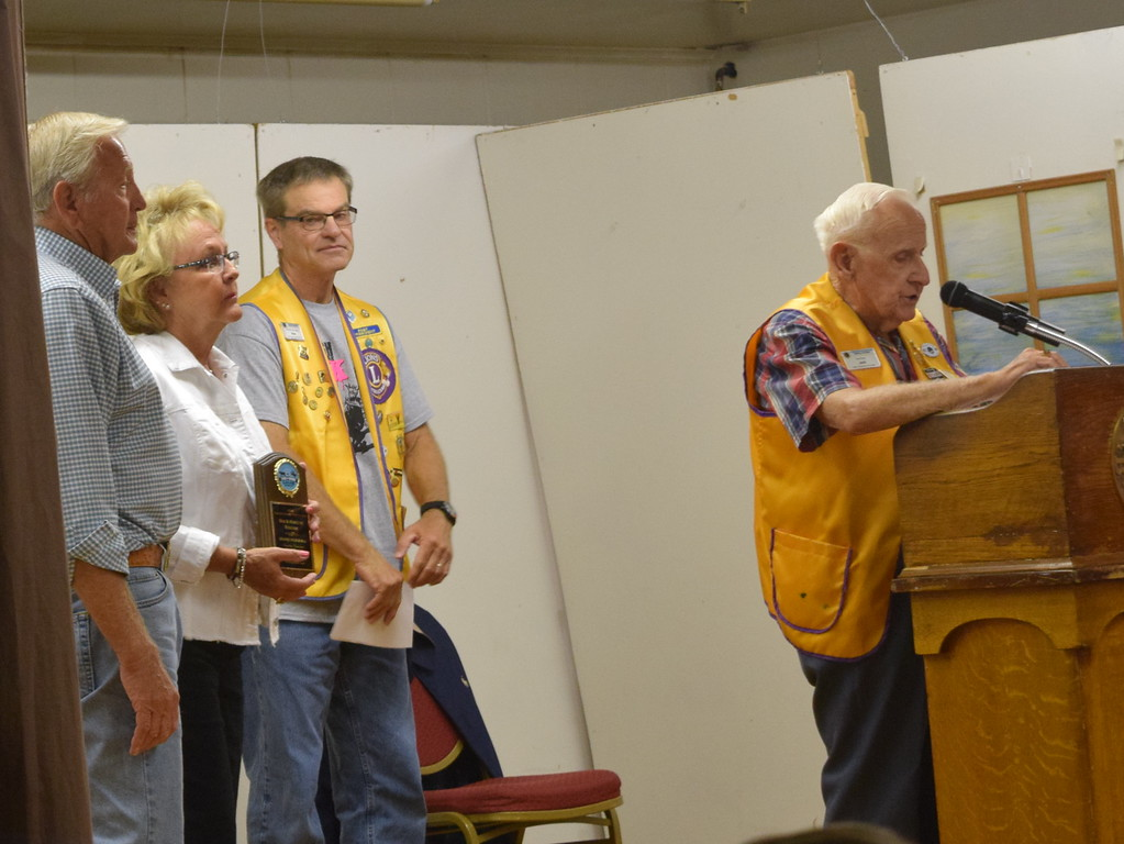 . Sterling Lions Club member Jack Annan says a few words about the 2018 Logan County Fair Parade Marshals Bob and Marilyn Kircher as Lion Dave Fast presents them with an award during the Cowboy Breakfast Wednesday, Aug. 8, 2018.