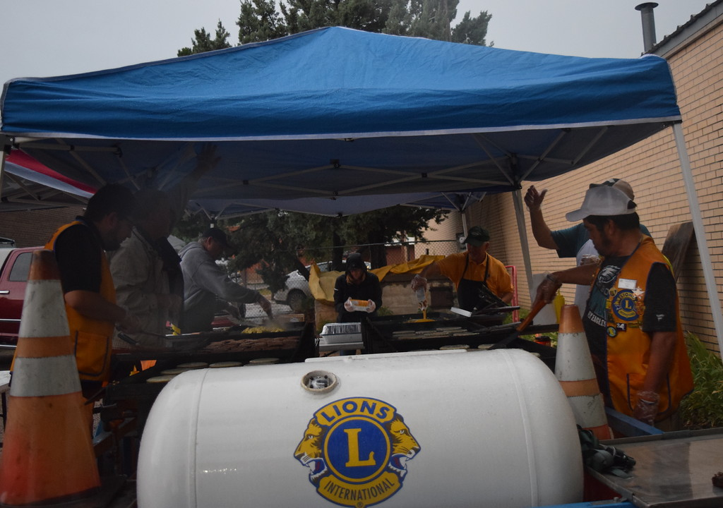 . Sterling Lions Club members man the grill, cooking up pancakes, sausage and scrambled eggs, on a rainy Wednesday, Aug. 8, 2018, for the club\'s 66th annual Cowboy Breakfast.