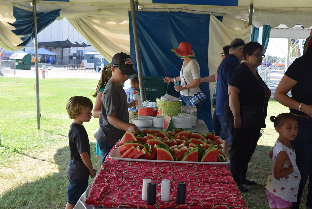 . Fairgoers were treated to a delicious watermelon treat at the annual George and Minnie Korrey Memorial Watermelon Feed Saturday, Aug. 11, 2018, at the Logan County Fair.