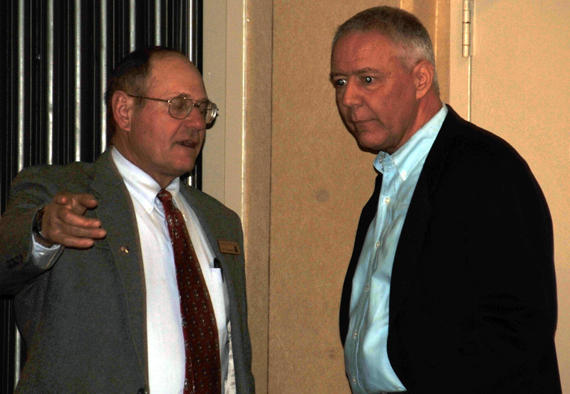 U.S. Senate candidate Ken Buck, right, visits with a guest at the Logan County Republicans Lincoln Day Dinner, Saturday, Feb. 15, 2014.