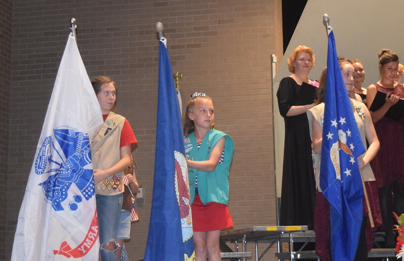"Members of Girl Scout Troops #76180, 73910 and 82586 hold up flags for each branch of the military during Master Chorale's performance of ""Armed Forces- The Pride of America!"" at the chorale's 28th annual Spring Concert Sunday, May 5, 2019."