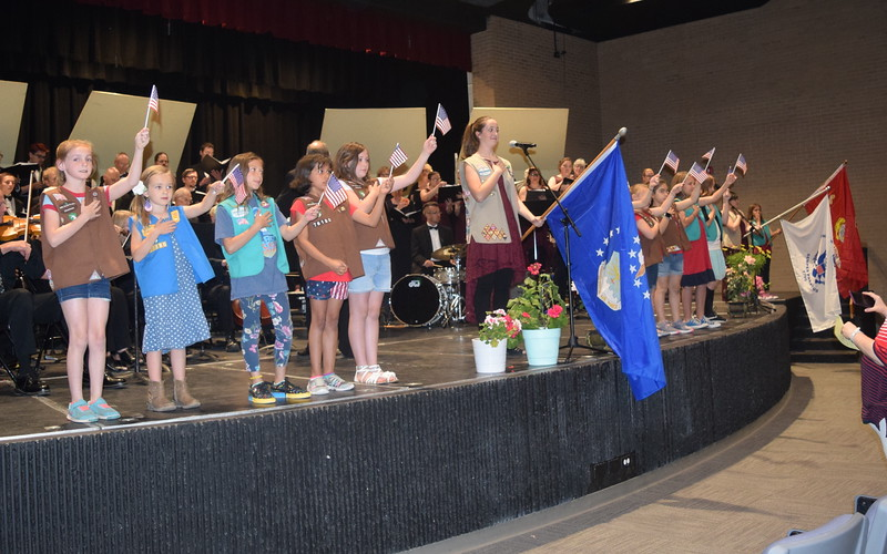 "Members of Girl Scout Troops #76180, 73910 and 82586 wave American flags and flags representing each military branch during Master Chorale and Sterling High School Jazz Choir's performance of ""Armed Forces- The Pride of America!"" at the chorale's 28th annual Spring Concert Sunday, May 5, 2019."