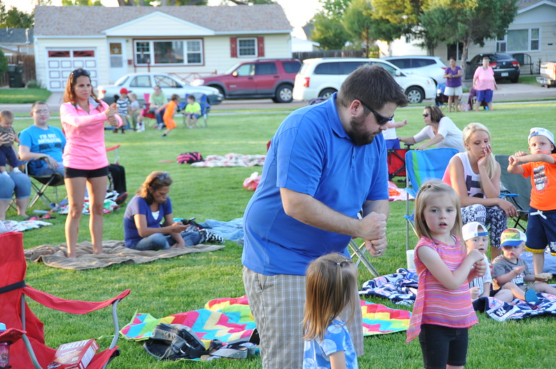 Movie-goers try some tai chi moves at Wisdom Park Tuesday, June 2, 2015. (Sara Waite/Journal-Advocate)