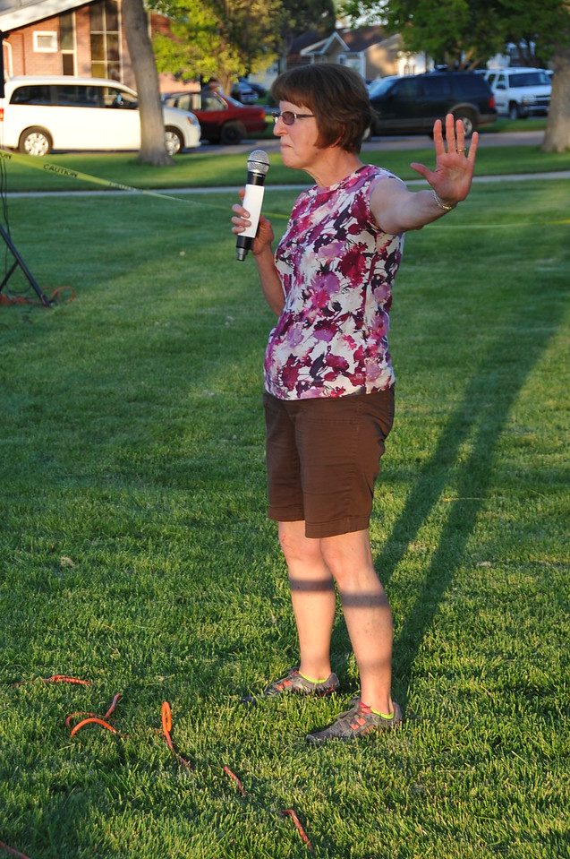 "Tai chi instructor Kathy Graham teaches some moves based on water before the start of ""Big Hero 6"" during the Parks, Library and Recreation Department's Movie in the Park night Tuesday. (Sara Waite/Journal-Advocate)"