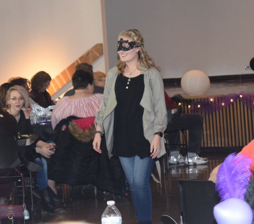 . A model shows off an outfit from Ella J\'s during Northeastern Junior College Cosmetology\'s Masquerade Fashion Show Fundraiser Saturday, March 9, 2019.