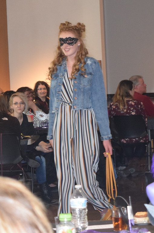 . A model shows off an outfit from Maurice\'s during Northeastern Junior College Cosmetology\'s Masquerade Fashion Show Fundraiser Saturday, March 9, 2019.