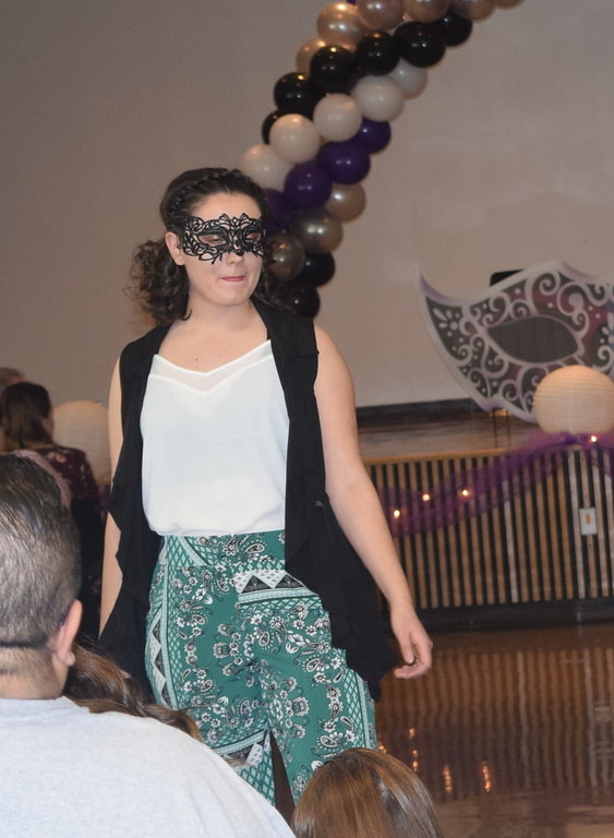 . A model shows off her outfit from Maurice\'s during Northeastern Junior College Cosmetology\'s Masquerade Fashion Show Fundraiser Saturday, March 9, 2019.