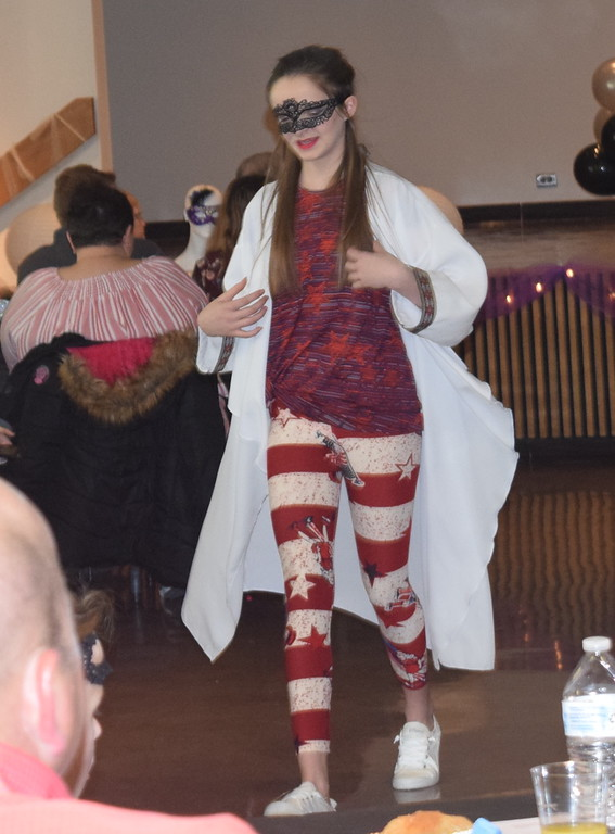 . A model shows off an outfit from LuLaRoe during Northeastern Junior College Cosmetology\'s Masquerade Fashion Show Fundraiser Saturday, March 9, 2019.
