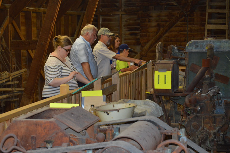 Guests view the equipment and read descriptions of how each item was used in the Lowery Tannery exhibit on the second floor of the Karg Barn at the Overland Trail Museum. (Sara Waite/Journal-Advocate)