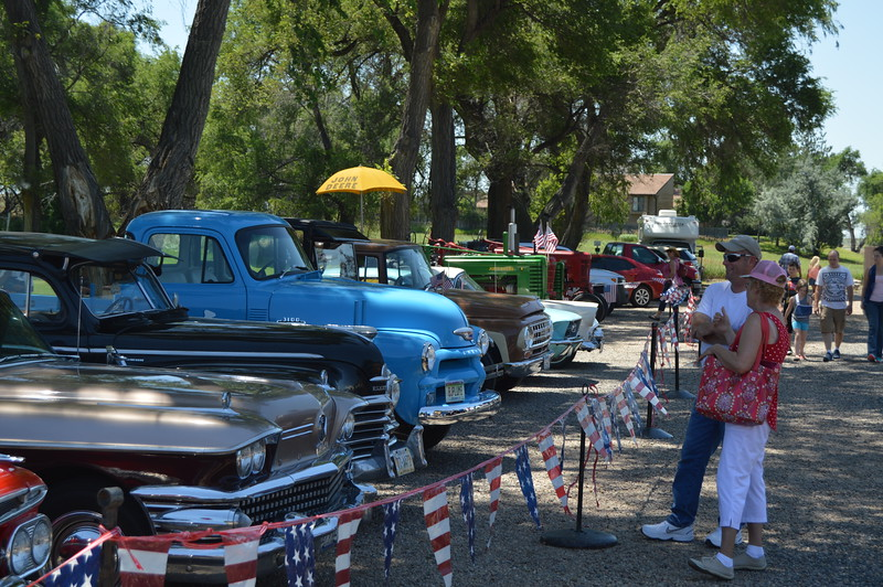 Heritage Festival-goers enjoy looking over the antique and classic cars and tractors on display next to Heidi Park. (Sara Waite/Journal-Advocate)