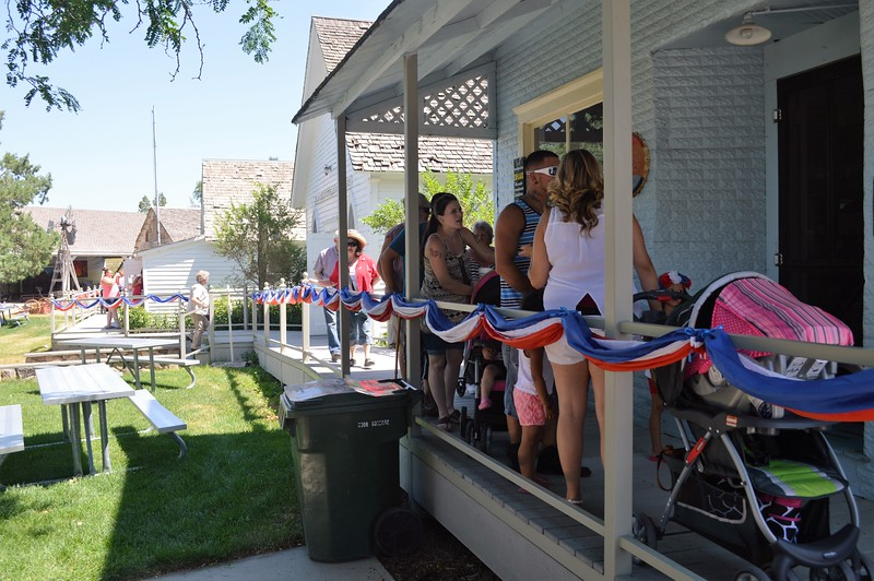 Festival-goers line the boardwalk of the Overland Trail Museum's village during Heritage Festival Monday, July 4, 2016. (Jeff Rice/Journal-Advocate)