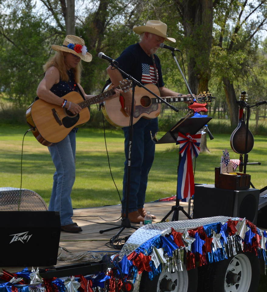 Bonnie Jo and Brad Exton, the Ramblin' Rangers, perform at Heidi Park for the Overland Trail Museum's annual Heritage Festival Monday, July 4, 2016. (Sara Waite/Journal-Advocate)