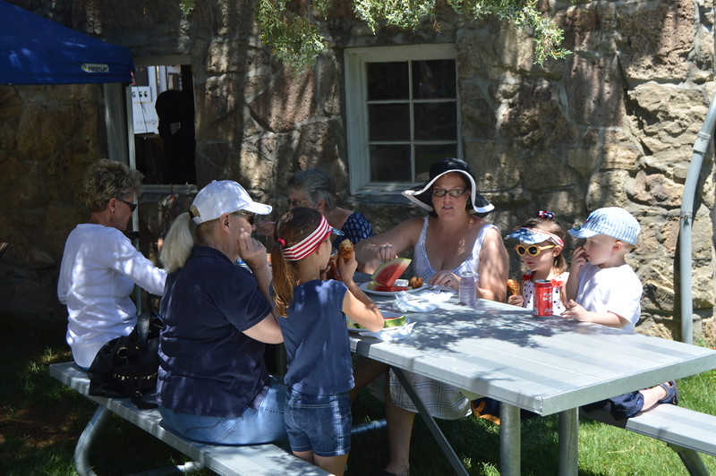 Visitors enjoy a picnic lunch in the courtyard of the Overland Trail Museum during the Heritage Festival. (Sara Waite/Journal-Advocate)