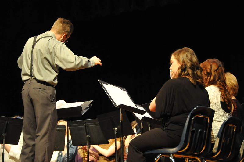"Band teacher Lee Lippstrew conducts as the Sterling High School Concert Band plays ""Forrest Gump Suite"" during the Winter Concert Thursday, Dec. 18, 2014."