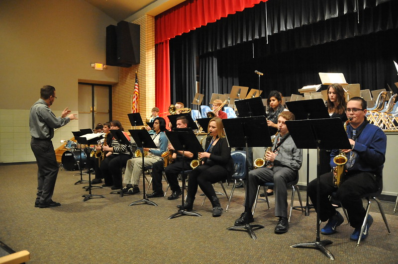 Band teacher Lee Lippstrew conducts during the Sterling High School Jazz Band performance Thursday, Dec. 18, 2014.