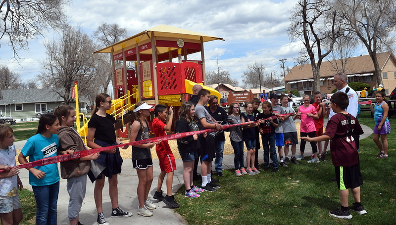 "Sterling Fire Department personnel use the ""Jaws of Life"" to cut the ribbon on a newly opened fire department-themed playground at Monahan Park during the city of Sterling's Arbor Day celebration Friday, April 26, 2019."