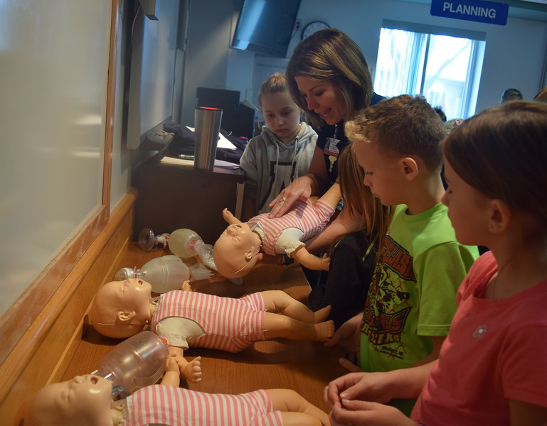 Kendall Rubottom, clinical education specialist, teaches Caliche, Fleming, Merino and Peetz third graders how to perform CPR on a baby during a tour of Sterling Regional MedCenter Wednesday, April 24, 2019.