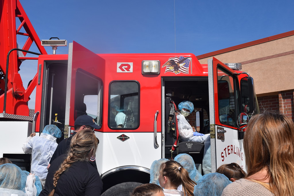 . Fleming and Merino Elementary third graders take turns climbing on board one of Sterling Fire Department\'s trucks during a tour of Sterling Regional MedCenter Wednesday, April 24, 2019.
