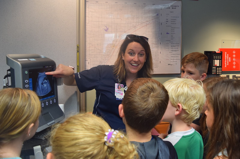 Marci Dowis, trauma coordinator and nurse at Sterling Regional MedCenter, shows Caliche, Fleming, Merino and Peetz third graders an image of her baby on an ultrasound machine during a tour of the hospital Wednesday, April 24, 2019.