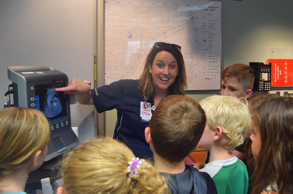 . Marci Dowis, trauma coordinator and nurse at Sterling Regional MedCenter, shows Caliche, Fleming, Merino and Peetz third graders an image of her baby on an ultrasound machine during a tour of the hospital Wednesday, April 24, 2019.