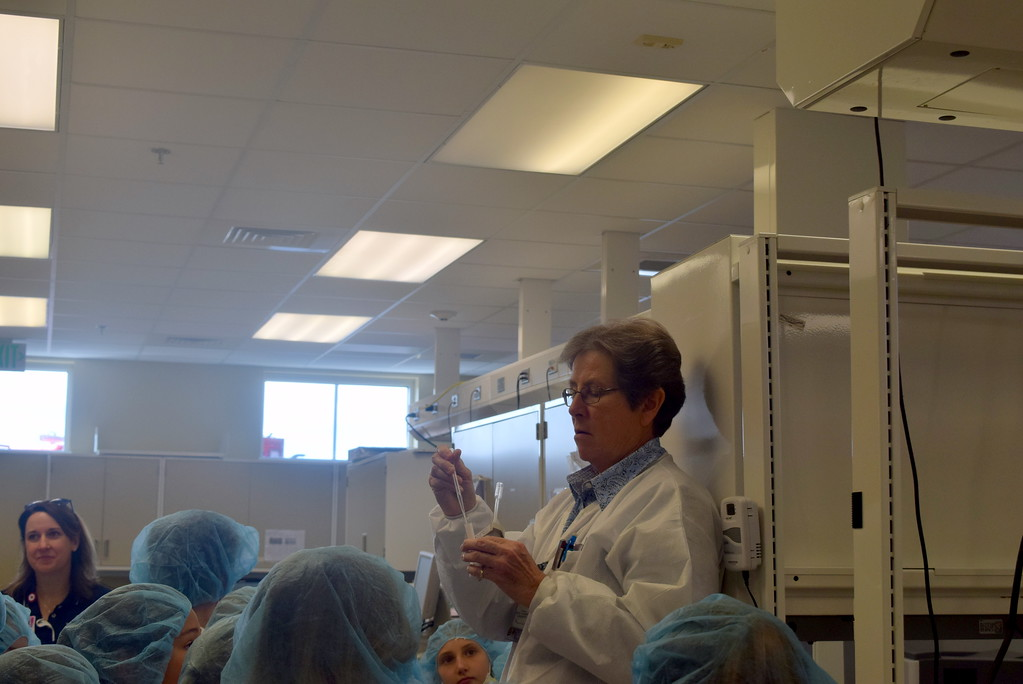 . A medical technician does an experiment showing chemical reaction as part of Fleming and Merino Elementary third graders\' tour of Sterling Regional MedCenter Wednesday, April 24, 2019.