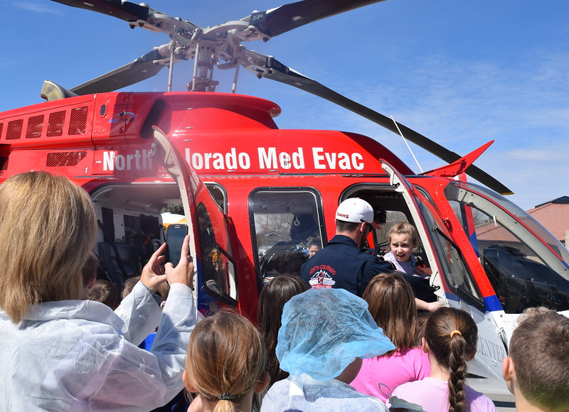Peetz and Caliche Elementary students take turns sitting on board the North Colorado Med Evac helicopter during a tour of Sterling Regional MedCenter Wednesday, April 24, 2019.