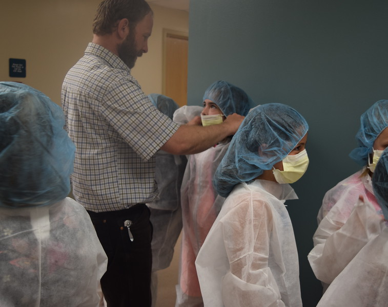 Fleming and Merino Elementary third graders gear up in surgical wear in preparation to enter an operating room during a tour of Sterling Regional MedCenter Wednesday, April 24, 2019.