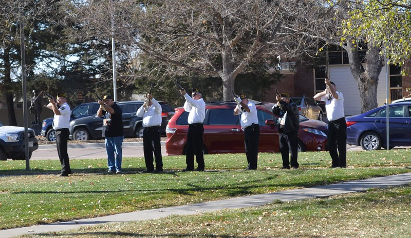 A 21-gun salute marks the end of the Veterans Day service at Columbine Park in Sterling, Colo. 11.11.16