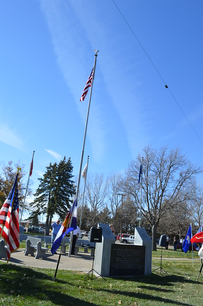 Flags fly at the Columbine Park Veterans Memorial in Sterling during the Veterans Day service Friday, Nov. 11, 2016.